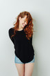 Seductive coy young redhead woman laughing