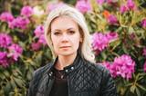 Outdoor portrait of beautiful blond woman wearing black leather jacket - 192955086