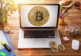 Bitcoin gold coin with laptop on wooden office table. - 192956616