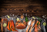 Fresh tasty seafood served on old wooden table. - 192957208