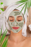 Young healthy woman with face clay mask. - 192957623