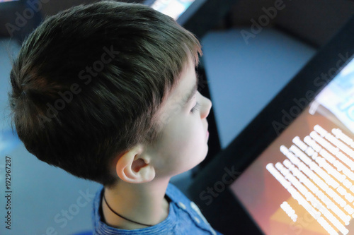 child examines the touchscreen in the interactive Museum