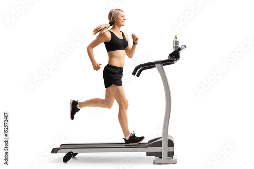 Foto op Canvas Jogging Young woman running on a treadmill