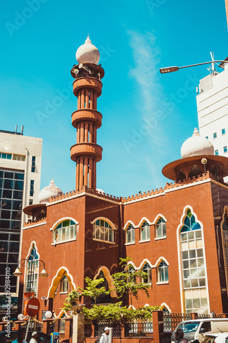 Fotobehang Kuala Lumpur Kuala Lumpur cityscape. Religious architecture. Travel to Malaysia. Mosque Masjid India. City tour. Tourism industry. Building facade. Urban background. Vertical