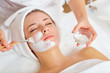 Leinwanddruck Bild - Woman in mask on face in spa beauty salon.