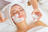 Woman in mask on face in spa beauty salon. - 192984281
