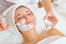 """Постер, картина, фотообои """"Woman in mask on face in spa beauty salon."""""""
