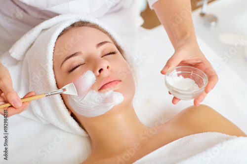Leinwandbild Motiv Woman in mask on face in spa beauty salon.