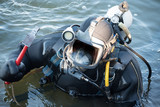 commercial  diver with scuba gear working in the water, occupation in the offshore industry - 192989477