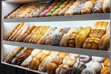 bread, buns and bakery products on the counter in the store