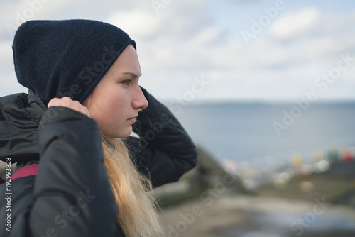 closeup portrait of teen girl walking in a city on autumn day