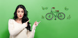 Eco Bicycle with young woman on a green background - 193002878