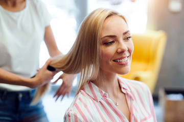 Happy woman at the hair salon © nd3000
