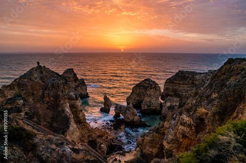 Papiers peints Marron chocolat Farol da Ponta da Piedade Algarve Lagos Coastline with cliffs and rocks at Portugal ocean during sunset sunrise