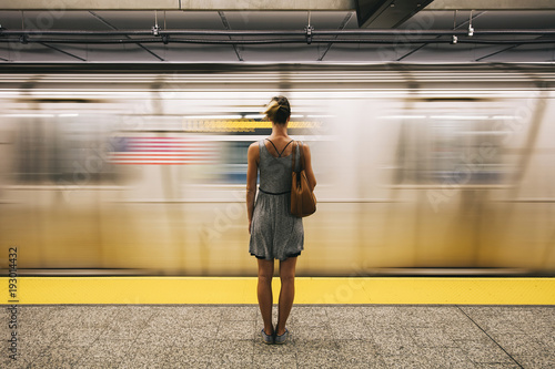 young-woman-waiting-for-subway-train-in-new-york-city