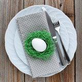 Easter table setting with white egg