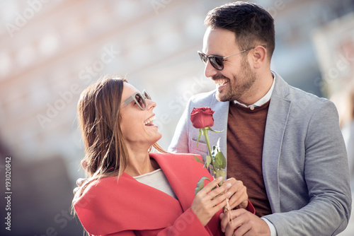 Fototapeta Young couple with rose, outdoors