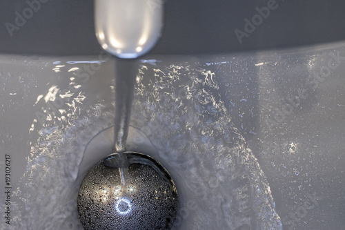 Water coming out of the basin tap