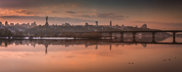 Winter evening, beautiful city panorama, view of the Kiev-Pechersk Lavra, Dnipro river, Kyiv, Ukraine