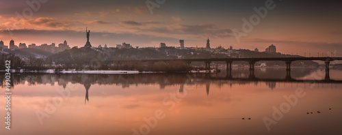 Aluminium Bruggen Winter evening, beautiful city panorama, view of the Kiev-Pechersk Lavra, Dnipro river, Kyiv, Ukraine