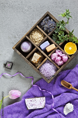 Ingredients for aromatherapy and spa treatments, aromatic sea salt and towels. Spa kit for beauty and health on a white wooden background. Close up, selective focus, shallow depth of field