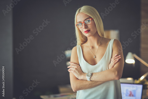 Wall mural Portrait of an executive professional mature businesswoman sitting on office