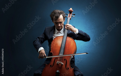 Fotobehang Muziek Cellist playing on instrument with empathy