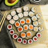 set of different kinds of Japanese sushi rolls with chopsticks and avocado © aksinya1991
