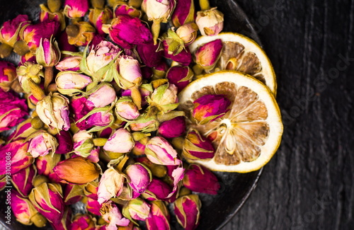 Rose tea buds on dark plate