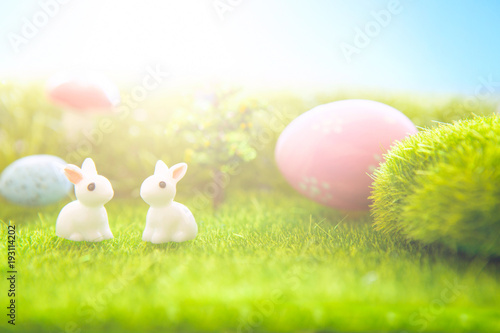 Fotobehang Lime groen Spring meadow with miniature easter rabbits and easter eggs