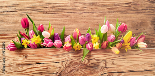 Fresh spring flowers on an Easter banner - 193122290