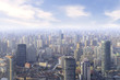 Quadro aerial view of Shanghai cityscape and modern skyscraper city in misty sky background behind pollution haze, in Shanghai, China.