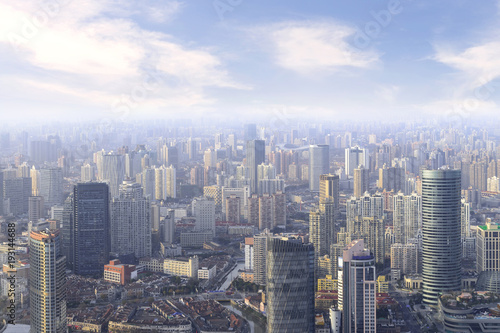 Fotobehang Shanghai aerial view of Shanghai cityscape and modern skyscraper city in misty sky background behind pollution haze, in Shanghai, China.