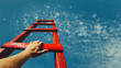 Leinwandbild Motiv Development Attainment Motivation Career Growth Concept. Mans Hand Reaching For Red Ladder Leading To A Blue Sky