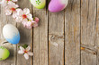 Easter eggs, Almond flowers on old wooden table