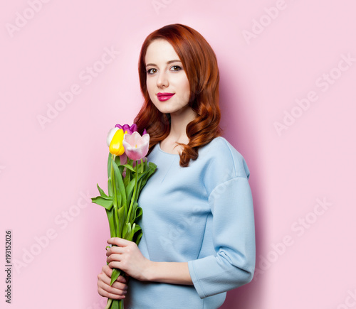 Young girl with bouquet of tulips