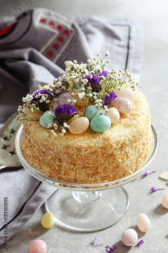Homemade Coconut Cake With Easter Candies decoration, selective focus