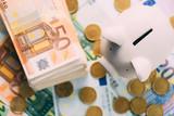 Piggy moneybox with euro cash and coins closeup. Financial concept - 193167005