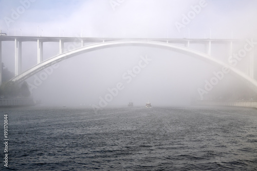 Arrabida bridge in the fog
