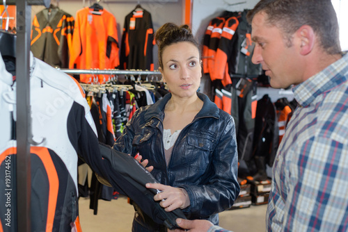 customer chooses moto equipment in motorcycle store