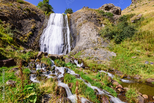 Artsci waterfall - a beautiful waterfall and natural landmark near Stepantsminda (Kazbegi) village, Caucasus mountains, Georgia - 193176824
