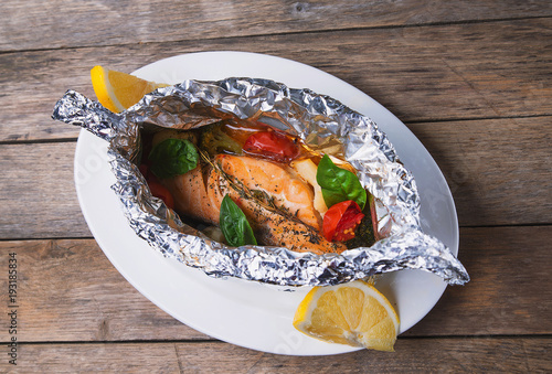 Salmon baked in foil with spices and lemon - 193185834