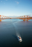 A span of the Forth Rail Bridge and a sightseeing boat which has just sailed under it, viewed from the footpath of the Forth Road Bridge - 193187292