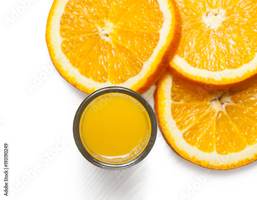 Orange juice glass and orange slices are isolated on a white background