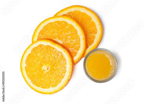 Orange juice glass and orange slices on a white background