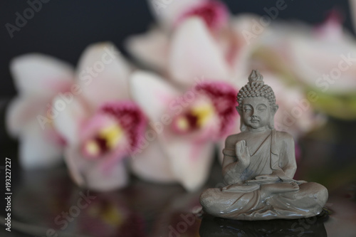 Staande foto Boeddha Buddha figure in the water and orchid flowers . Buddhism and philosophy concept. Spa concept