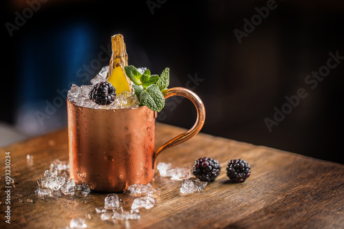 Tuinposter Moskou Moscow mule cocktail alcoholic drink on bar counter in pub or restaurant.