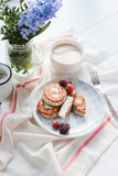 syrniki with poppy seeds on a wooden surface. concept of a healthy breakfast - 193259259