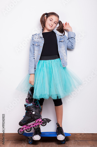 Aluminium Skateboard Cool teenager girl with active style of life posing for camera at home