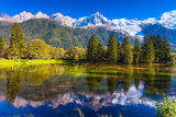 The lake reflected snow-capped Alps